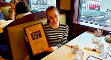 Happy customer enjoying lunch at Dino's Cafe in Bloomingdale