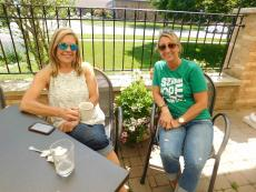 Friends enjoying breakfast on the patio at Downer's Delight in Downers Grove
