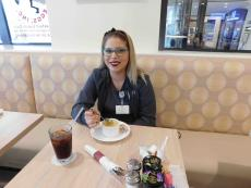 Happy customer at Eggs Inc. Cafe in Chicago (Streeterville)