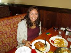 Customer enjoying pancakes at Eggs Inc. Cafe in Naperville