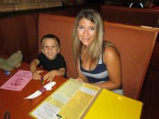Mother and son enjoying breakfast at Eggs Inc. Cafe in Bolingbrook