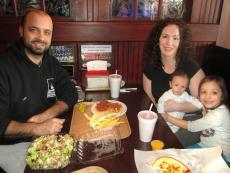 Family having dinner at Kostas Gyros Restaurant in Algonquin