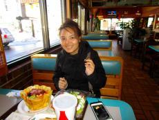 Customer enjoying the famous Taco Salad at Franksville Restaurant in Chicago