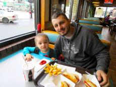 Father and daughter enjoying the famous hot dogs at Franksville Restaurant in Chicago