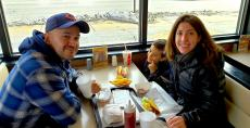 Family enjoying tacos and hot dogs at Franksville Restaurant in Chicago