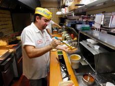 Hard working kitchen crew at Franksville Restaurant in Chicago