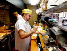 Hard working kitchen staff at Franksville Restaurant in Chicago