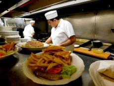 Busy kitchen staff at George's Family Restaurant in Oak Park
