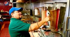 Slicing the famous gyros at Goodi's Restaurant in Niles