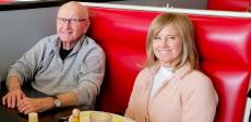 Family enjoying lunch at Gus' Diner in Rolling Meadows