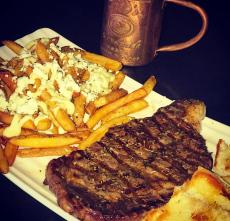 Greek style rib-eye and fries at Jimmy D's District Restaurant in Arlington Heights