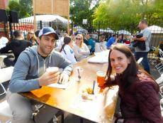 Couple enjoying Lincoln Park Greek Fest at St. George Greek Orthodox Church in Chicago