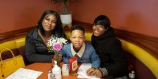 Family enjoying breakfast at Lumes Pancake House in Chicago