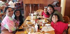 Family enjoying breakfast at Lumes Pancake House in Chicago