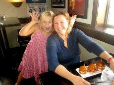 Mom and daughter enjoying a casual lunch at Manny's Ale House in Elmhurst