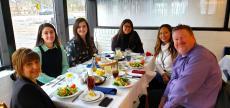 Friends enjoying lunch at Mykonos Greek Restaurant in Niles