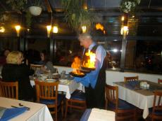 Serving the flaming Saganaki at Mykonos Greek Restaurant in Niles... OPA!