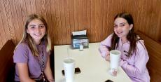 Friends enjoying soft drinks at Nick's Drive In Restaurant Chicago