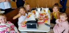 Kids enjoying lunch at Nick's Drive-In Restaurant in Chicago
