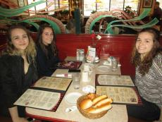 Friends enjoying lunch at Omega Pancake House in Downers Grove