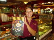 Friendly server with menus at Omega Restaurant & Pancake House in Downers Grove