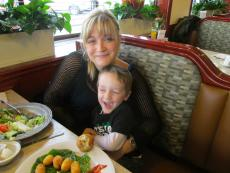 Mother and son enjoying lunch at Omega Restaurant & Pancake House in Downers Grove