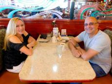 Couple enjoying lunch at Omega Restaurant & Pancake House in Downers Grove