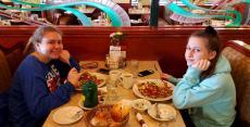 Friends enjoying breakfast at Omega Restaurant & Pancake House in Downers Grove