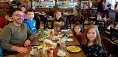 Family enjoying lunch at Omega Restaurant & Pancake House in Schaumburg
