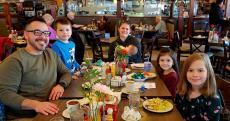 Family enjoying lunch at Omega Restaurant & Pancake House in Schaumburg