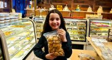 Happy young customer at Papagalino Cafe & Pastry Shop in Niles