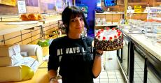 Friendly staff with sweet treat at Papagalino Cafe & Pastry Shop in Niles