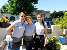 Friendly staff on the outdoor patio at Plateia Mediterranean Kitchen & Bar in Glenview