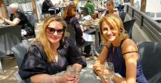 Friends enjoying the outdoor patio at Plateia Mediterranean Kitchen & Bar in Glenview