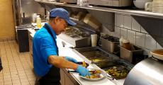 Hard working kitchen crew at QP Greek Food With a Kick Hoffman Estates