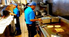 Hard working kitchen crew at QP Greek Food With a Kick Hoffman Estates
