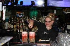 """Friendly bar server preparing """"Slammers"""" at Rocky's American Grill in Prospect Heights"""