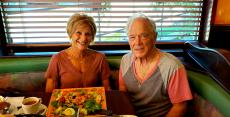 Happy couple enjoying dinner at Rose Garden Cafe in Elk Grove Village