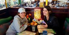 Friends enjoying dinner at Rose Garden Cafe in Elk Grove Village