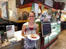 Happy customer enjoying pie at Rose Garden Cafe in Elk Grove Village