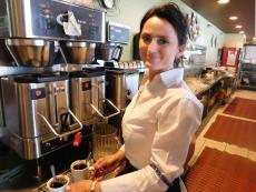 Friendly server with fresh coffee at Maxfield's Restaurant in Lombard