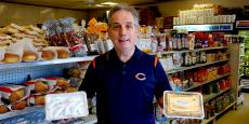 Staff with Greek pastries at Spartan Brothers Imported Foods in Chicago