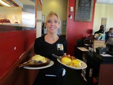 Hearty skillet and benedict served at Stacked Pancake House in Oak Lawn