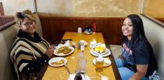 Mom and daughter enjoying breakfast at Tasty Waffle Restaurant in Romeoville