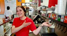 Friendly server with soft drinks at Teddy's Diner in Elk Grove Village