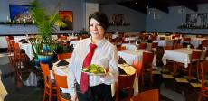 Server with Grecian Salad at Thassos Greek Restaurant in Palos Hills