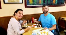 Couple enjoying the famous gyros at The Works Restaurant in Glenview
