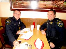 Police officers enjoying gyros at The Works Restaurant in Glenview