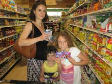 Family shopping for groceries at Village Market Place in Skokie