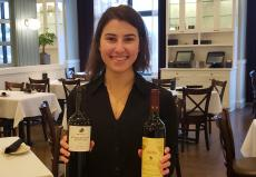 Manager with Greek Wine at Yanni's Restaurant in Glenview